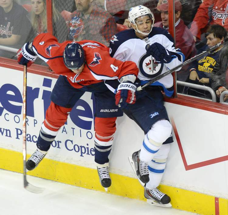 Washington Capitals defenceman John Erskine checks Winnipeg Jets left-winger Evander Kane during third-period action at the Verizon Center. (Chuck Myers / Tribune Media/MCT)