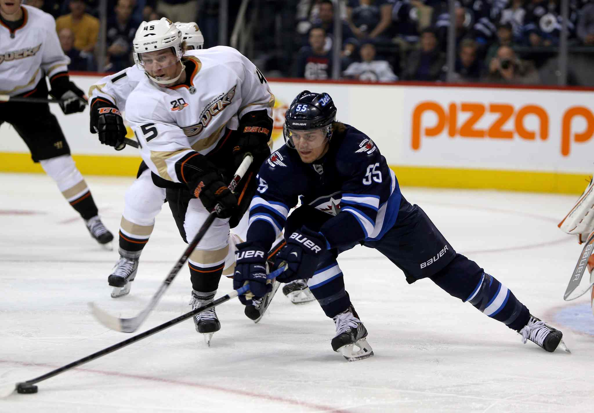 Anaheim Ducks' Sami Vatanen battles with Winnipeg Jets' Mark Scheifele in the second period.
