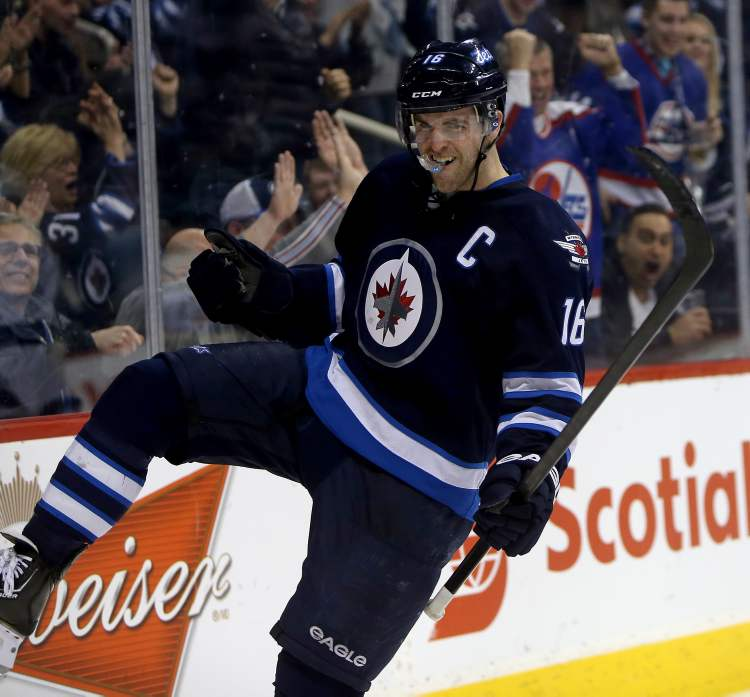 Winnipeg Jets captain Andrew Ladd celebrates after scoring his second goal of the game against the Tampa Bay Lightning during second-period NHL action at the MTS Centre in Winnipeg Tuesday. (Trevor Hagan / THE CANADIAN PRESS)