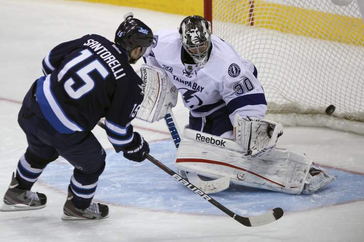 Winnipeg Jet Mike Santorelli beats Tampa Bay Lightning goaltender Ben Bishop in the shootout.