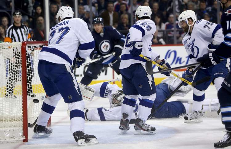Winnipeg Jets forward Blake Wheeler scores on Tampa Bay Lightning goaltender Ben Bishop with Tampa's Victor Hedman (77), Martin St. Louis (26) and Radko Gudas (75) looking on. (Trevor Hagan / THE CANADIAN PRESS)