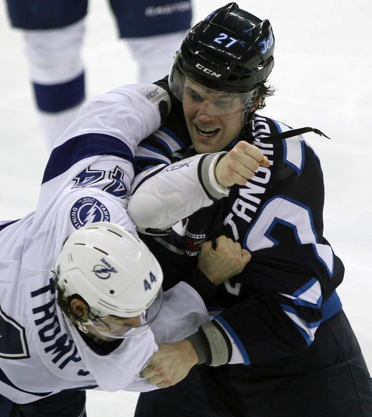 Winnipeg Jets' Eric Tangradi and Tampa Bay's Nate Thompson engage in a second-period scrap. (JOE BRYKSA / WINNIPEG FREE PRESS)