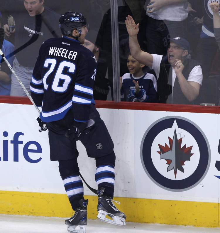 Winnipeg Jet Blake Wheeler celebrates his second-period goal. (JOE BRYKSA / WINNIPEG FREE PRESS)