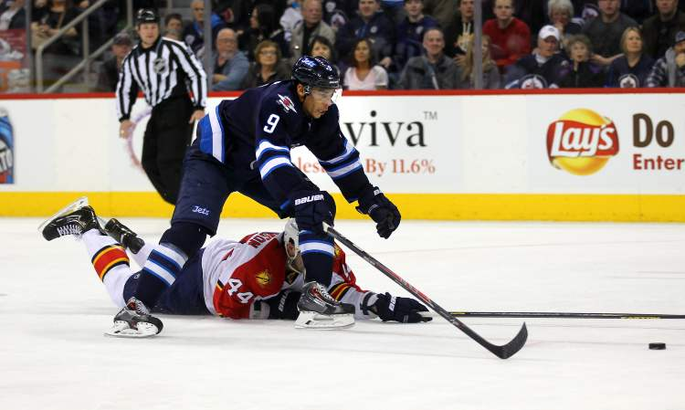 Winnipeg Jets forward Evander Kane skates over a fallen Erik Gudbranson in the second period to score his second goal against the Florida Panthers. (Phil Hossack / Winnipeg Free Press)