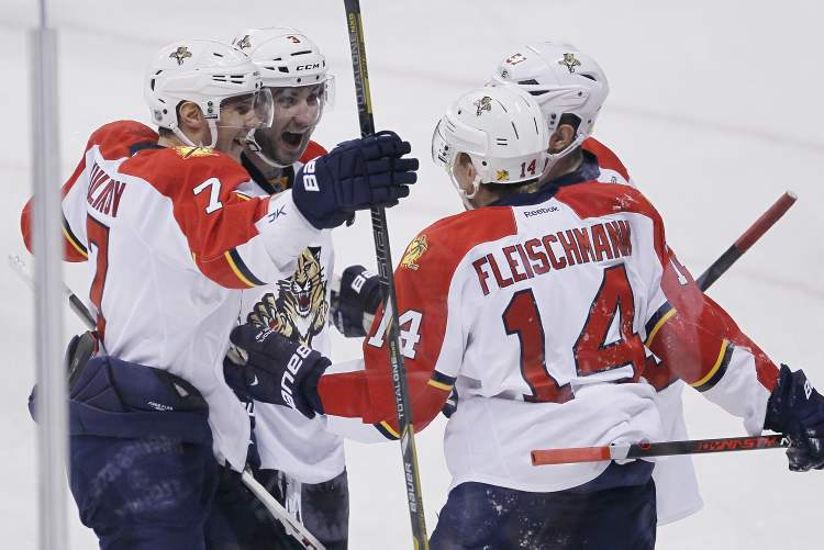 Florida Panthers Dmitry Kulikov (7), TJ Brennan (3), Tomas Fleischmann (14) and Marcel Goc (57) celebrate Fleischmann's goal against the Winnipeg Jets during first-period NHL action in Winnipeg Thursday. (JOHN WOODS / THE CANADIAN PRESS)