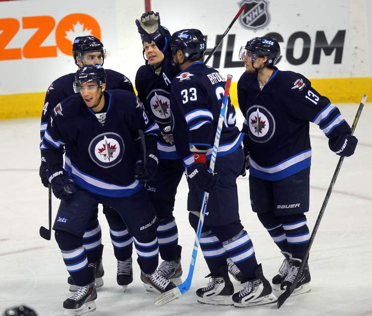 Winnipeg Jets Evander Kane, Grant Clitsome, Olii Jokinen, Dustin Byfuglien and Kyle Wellwood celbrate Kane's goal in the first period against the Florida Panthers.  (Phil Hossack / WInnipeg Free Press)