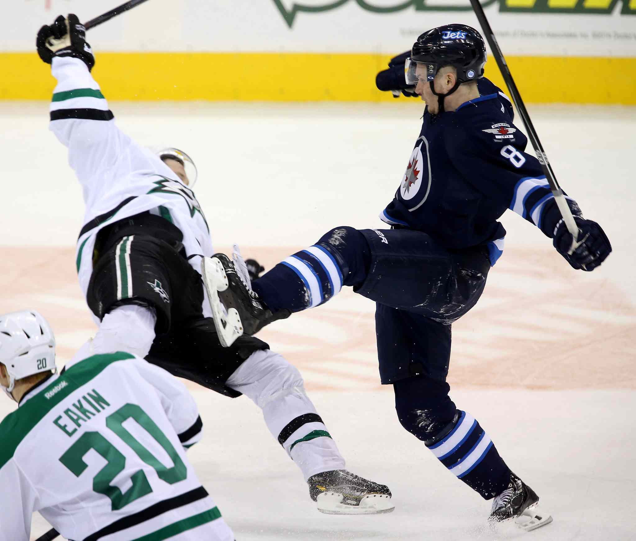 Stars forward Erik Cole is flattened by Jets rookie defenceman Jacob Trouba in the first period.