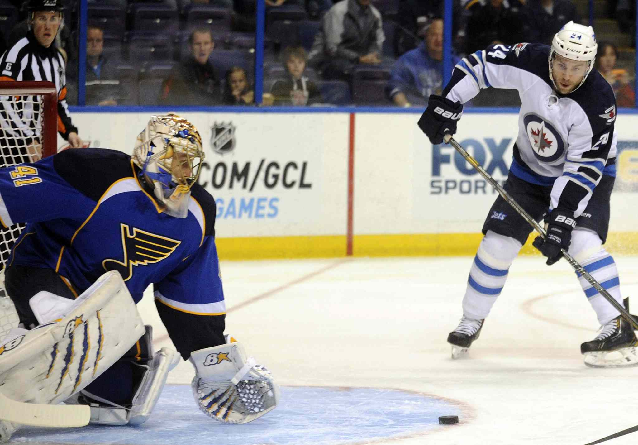 St. Louis Blues' goalie Jaroslav Halak blocks a shot by Winnipeg Jets defenceman Grant Clitsome in the first period.