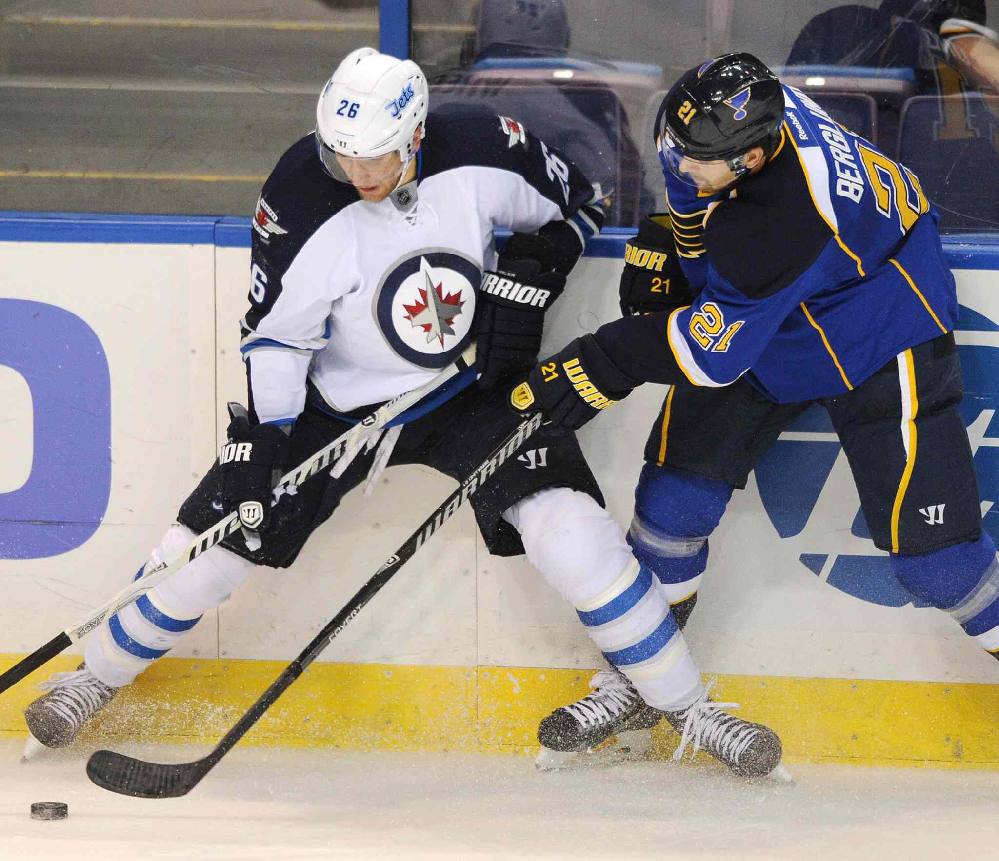 St. Louis Blues' Patrik Berglund and Winnipeg Jets' Blake Wheeler battle for the puck during the second period.