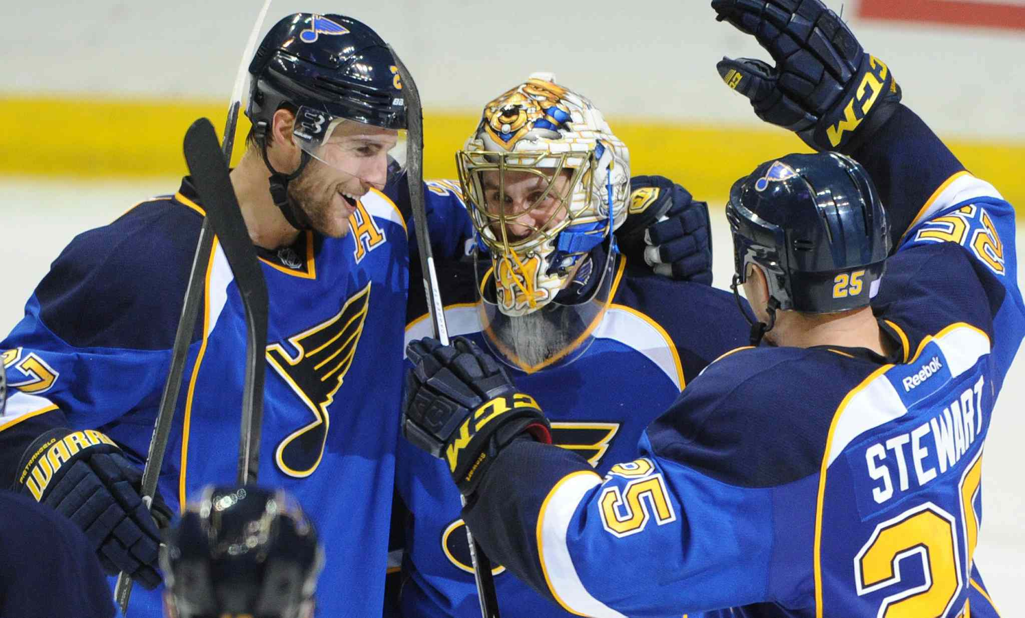 St. Louis Blues goalie Jaroslav Halak is congratulated by teammates Alex Pietrangelo (left) and Chris Stewart after the Blues' 3-2 victory over the Winnipeg Jets.