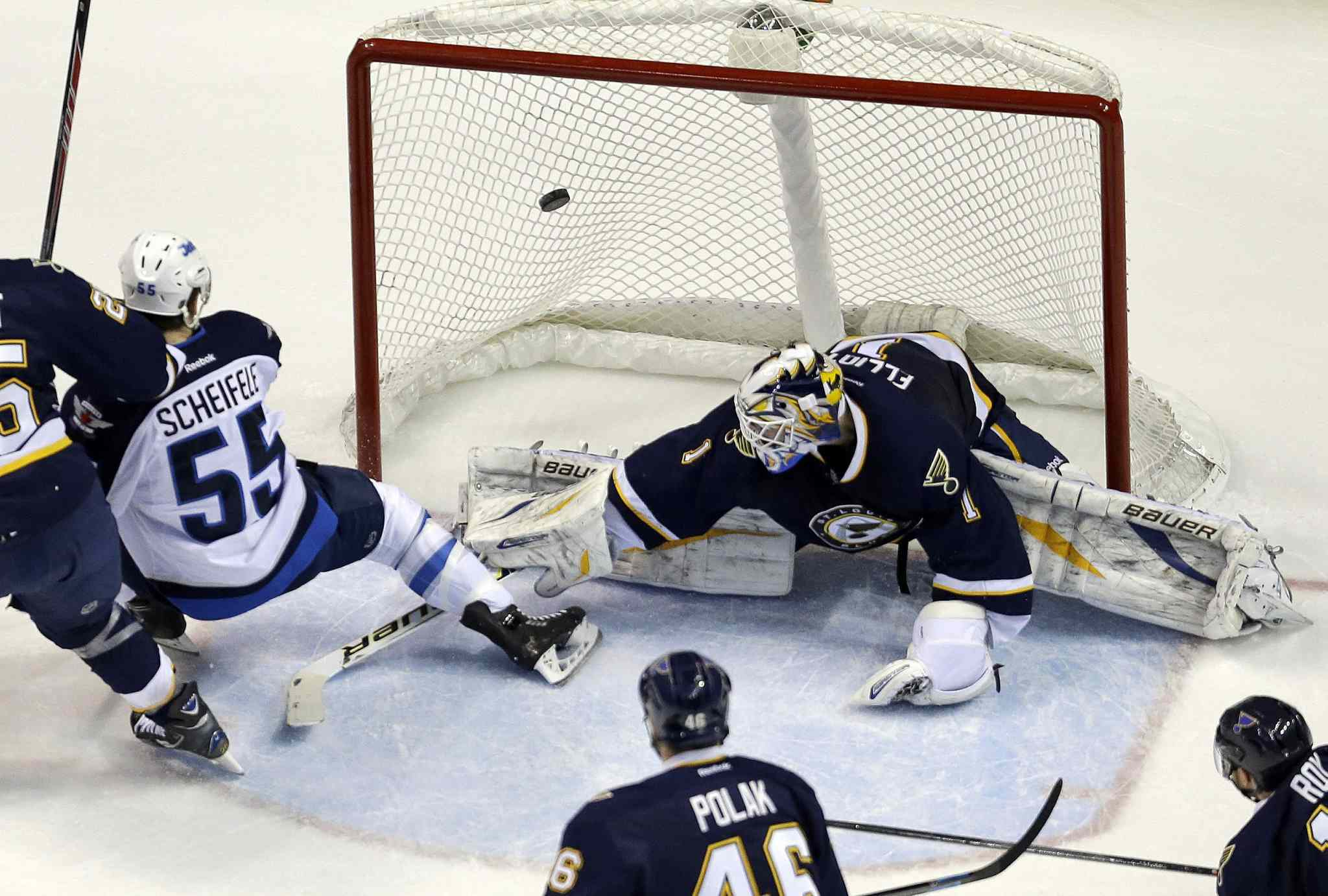 Winnipeg Jets' Mark Scheifele (55) scores a second-period goal past St. Louis Blues' goalie Brian Elliott during Saturday's game in St. Louis.