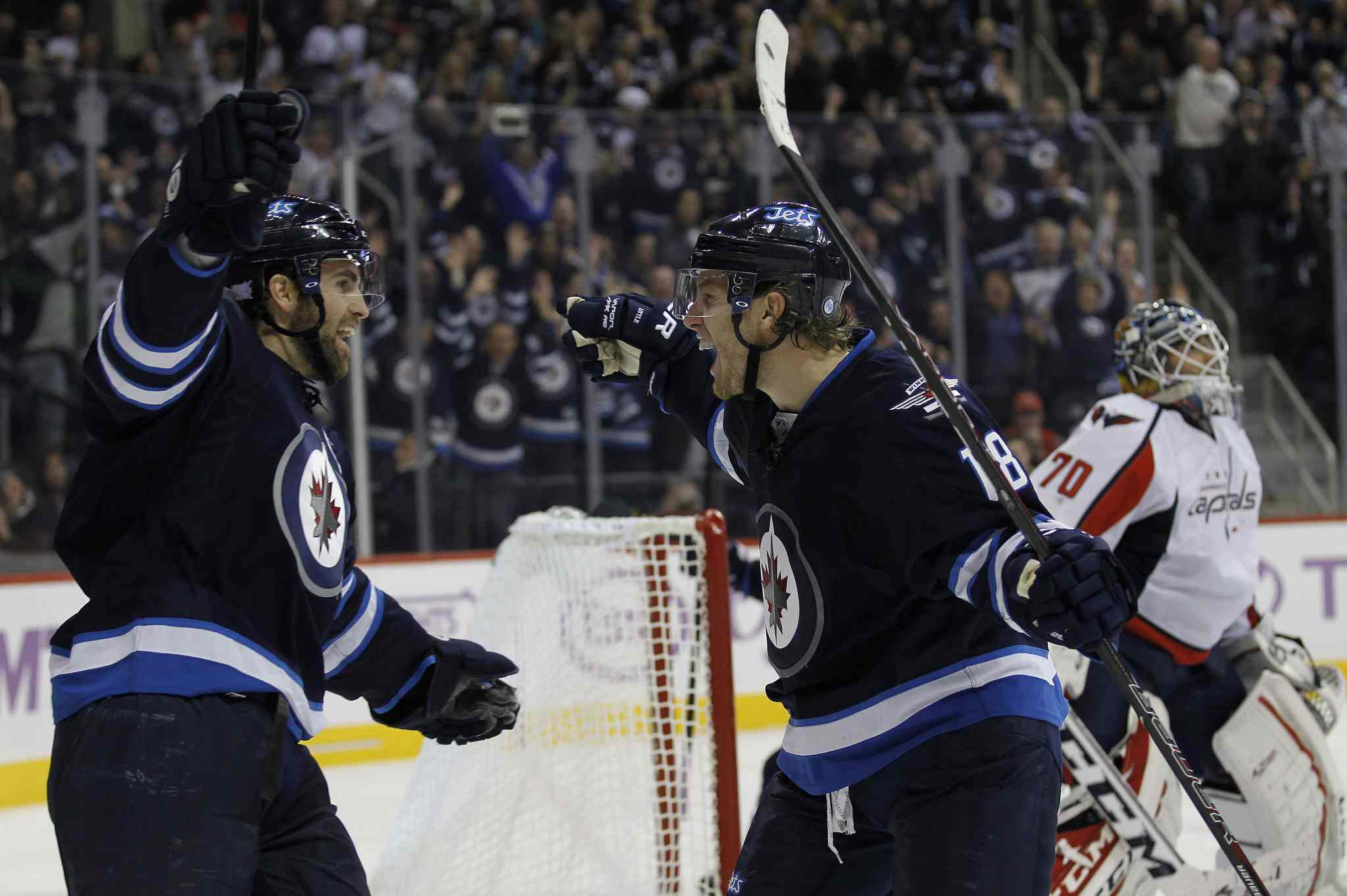 Winnipeg Jets captain Andrew Ladd (left) and teammate Bryan Little celebrate Little's goal against Washington Capitals goaltender Braden Holtby during the second period.