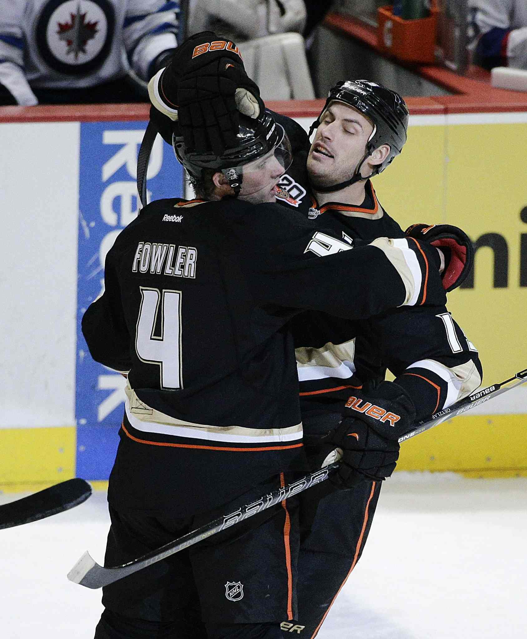 Anaheim Ducks' Cam Fowler, left, and Ryan Getzlaf celebrate a goal by Fowler during the first period of Tuesday's game against the Winnipeg Jets.