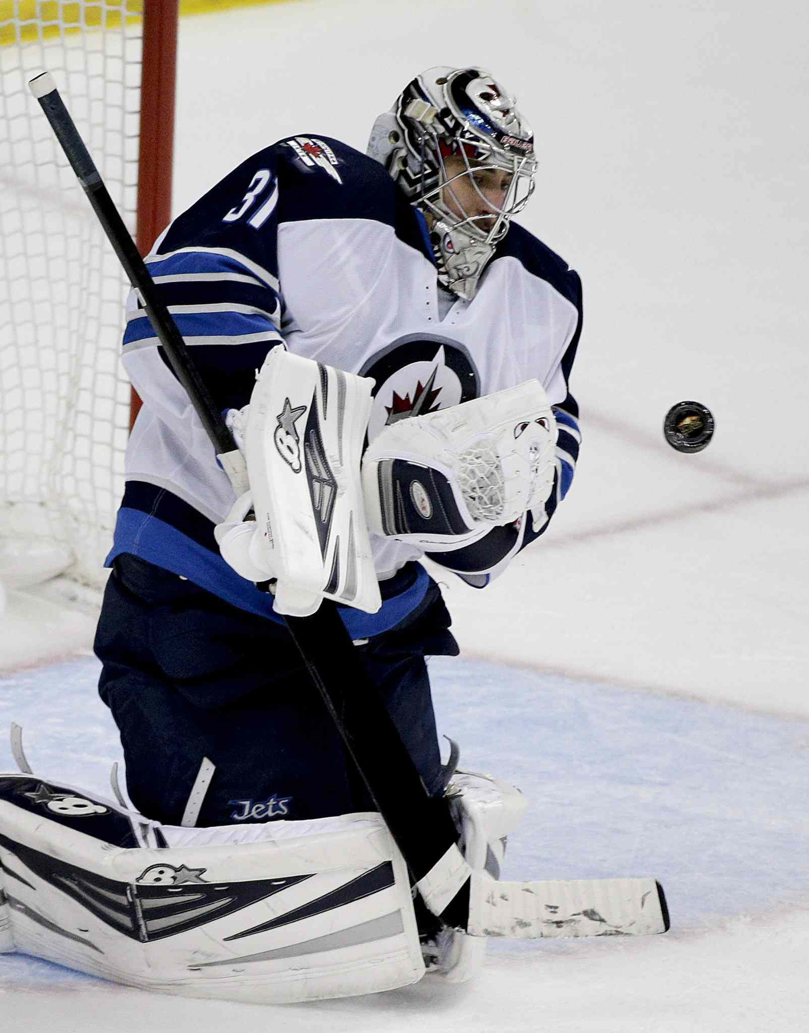 Winnipeg Jets' goalie Ondrej Pavelec makes a second-period save against the Anaheim Ducks Tuesday.