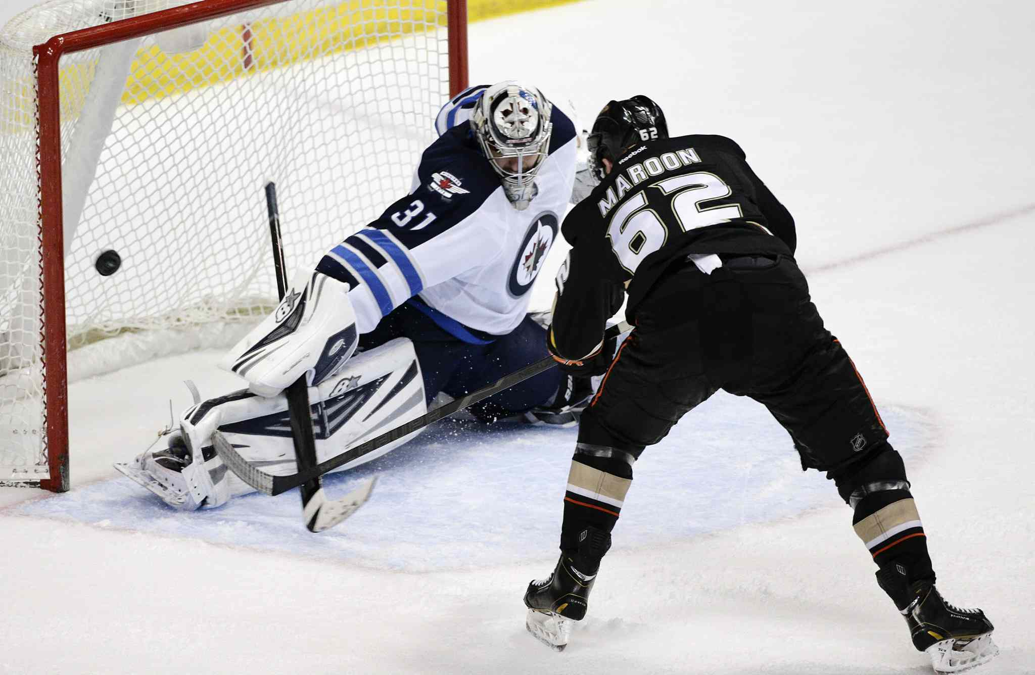 Winnipeg Jets' goalie Ondrej Pavelec deflects a second-period shot by Anaheim Ducks' Patrick Maroon in Anaheim Tuesday.