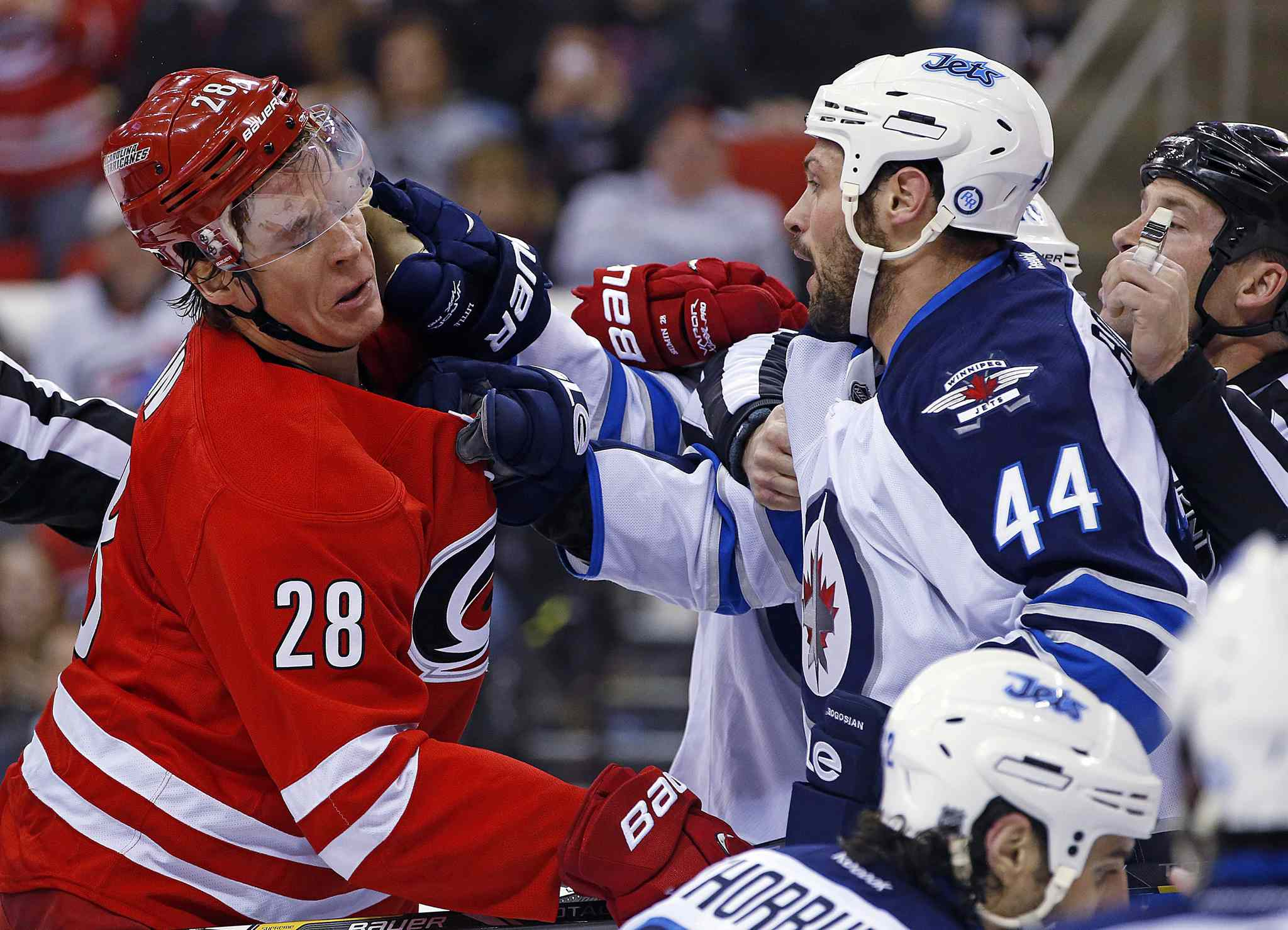 Carolina Hurricanes' Alexander Semin (28) and Winnipeg Jets' Zach Bogosian (44) have a second-period scuffle in front of the net during Tuesday's game.