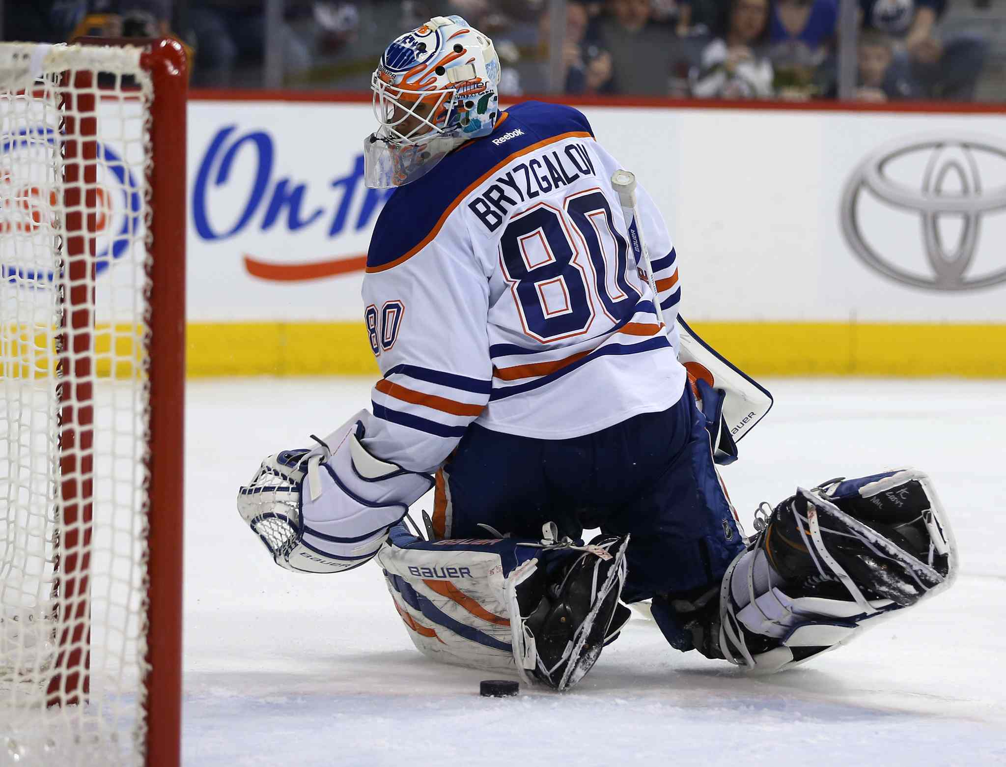 Edmonton Oilers' goaltender Ilya Bryzgalov makes an uncertain save on a drive by Winnipeg Jets' Dustin Byfuglien (33) in the second period of Saturday's NHL hockey game in Winnipeg.