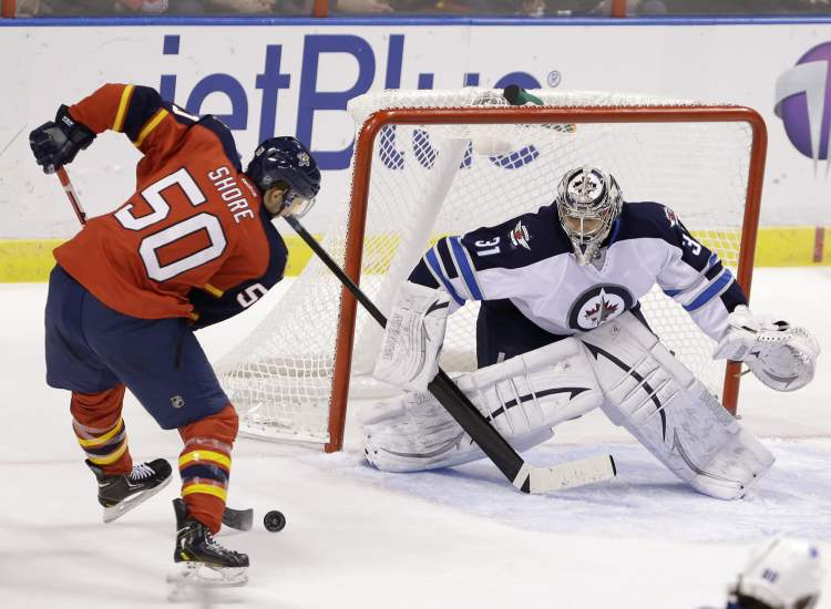 Florida Panthers forward Drew Shore attempts a shot at Winnipeg Jets goalie Ondrej Pavelec during the first period of an NHL game Thursday.
