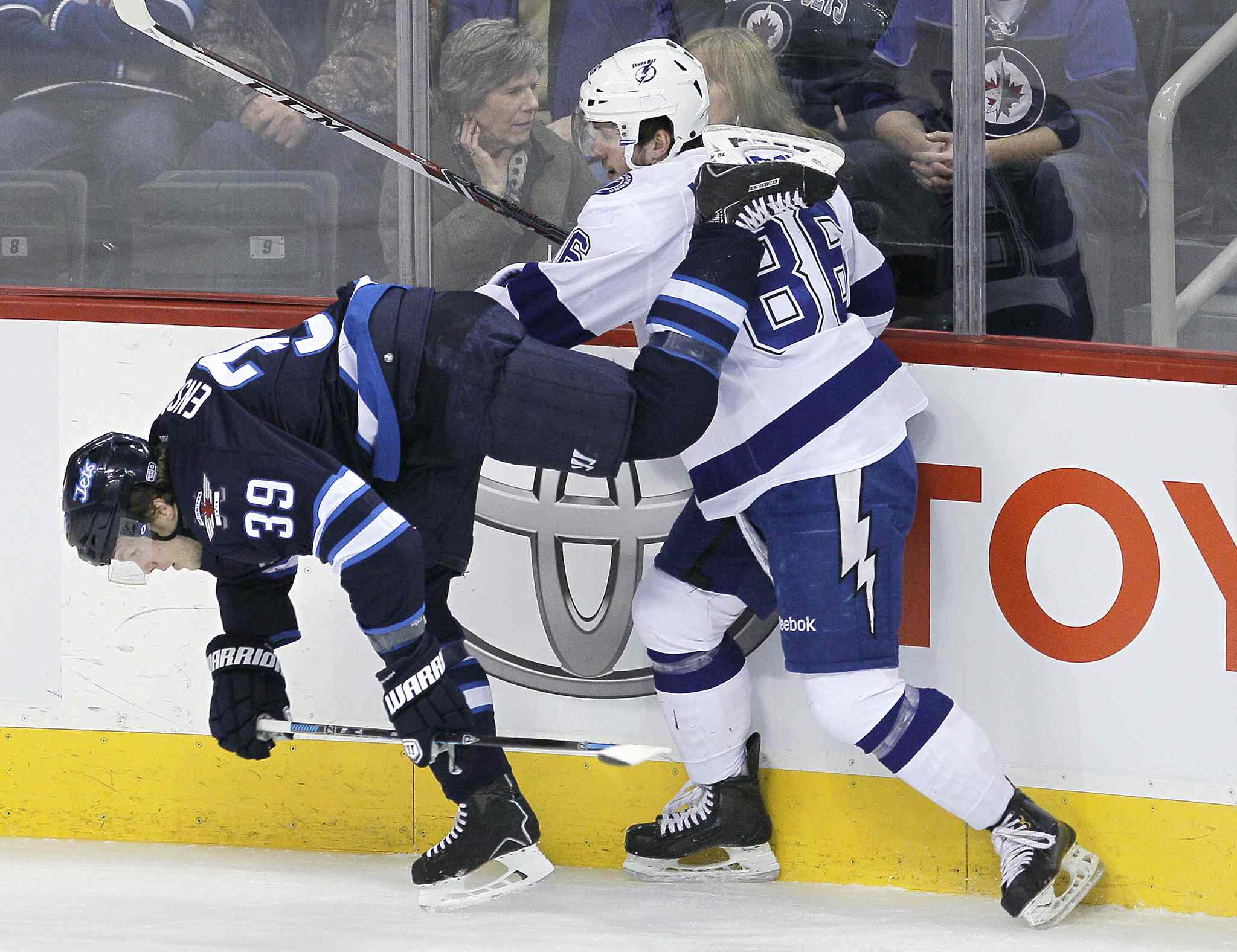 Winnipeg Jets' Tobias Enstrom (39) is checked by Tampa Bay Lightning's Nikita Kucherov (86) during the first period Tuesday.