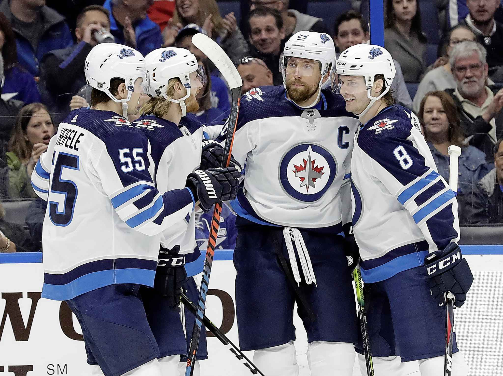 Winnipeg Jets right wing Blake Wheeler celebrates his goal against the Tampa Bay Lightning with teammates, including centre Mark Scheifele and defenceman Jacob Trouba, during the first period Tuesday.