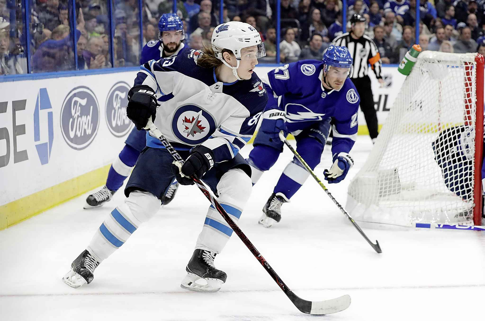 Winnipeg Jets defenceman Sami Niku carries the puck ahead of Tampa Bay Lightning defenceman Ryan McDonagh during the first period Tuesday.