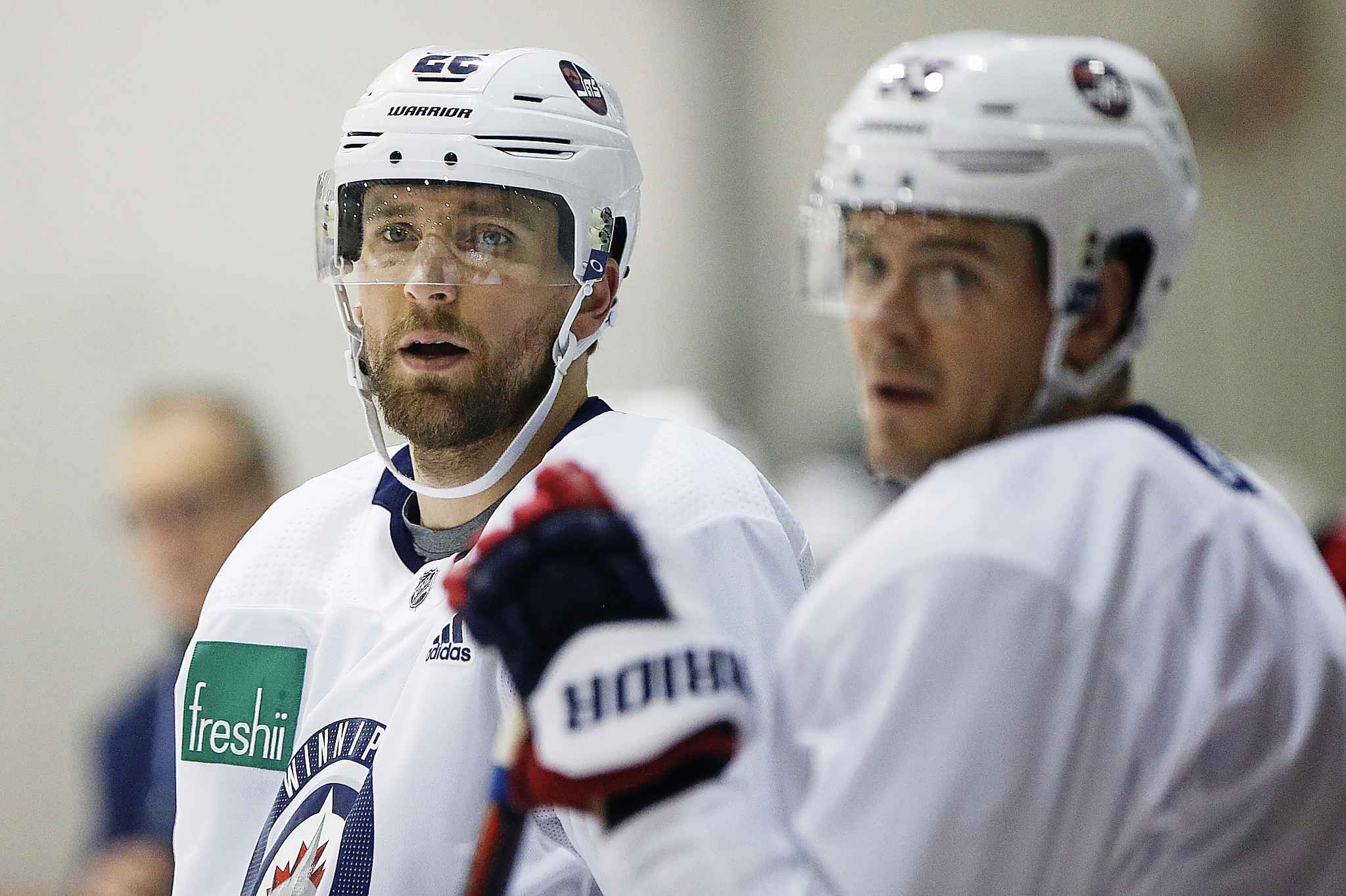 Former Jets line mates Blake Wheeler, left, and Mark Scheifele both have had success scoring since being separated.