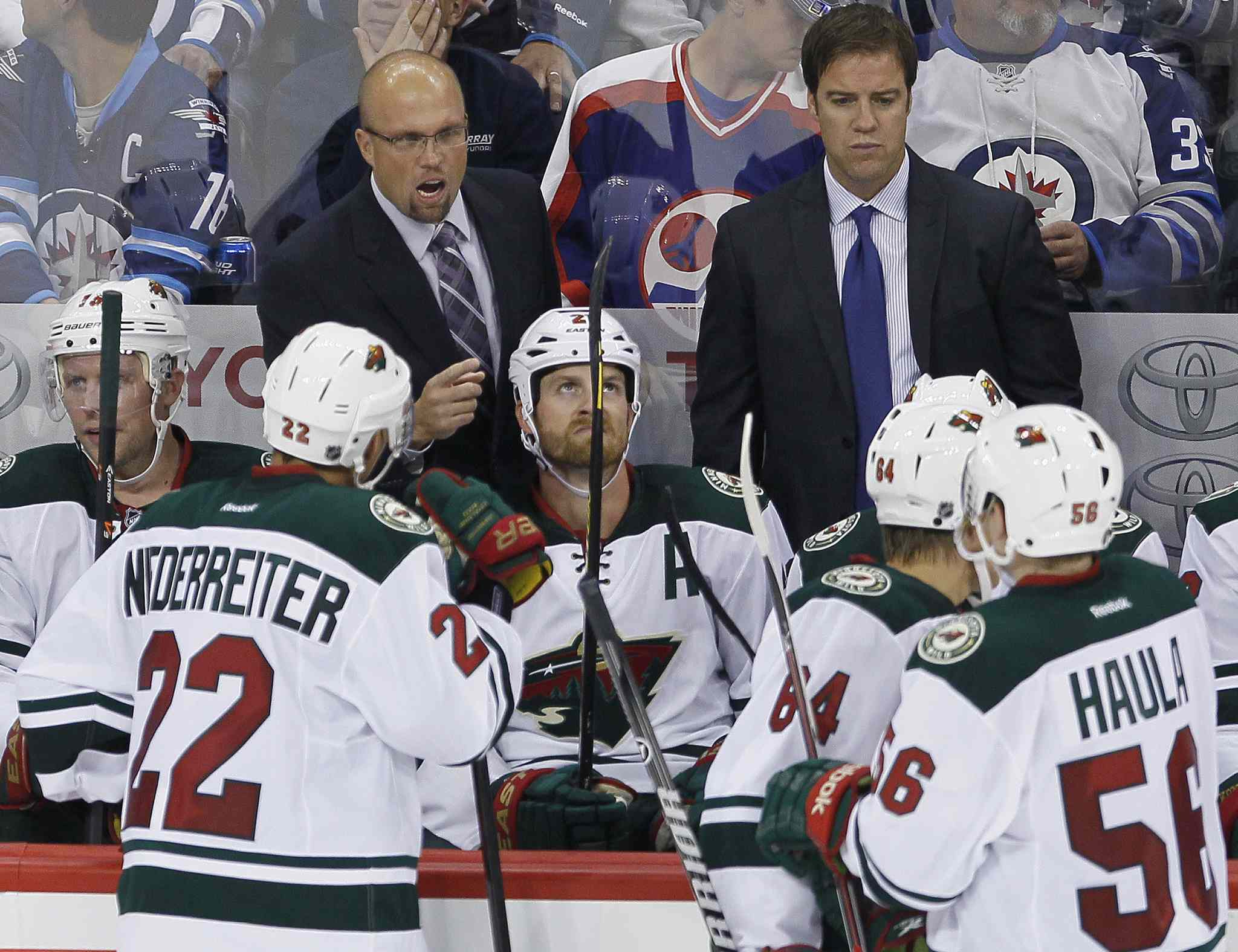 Minnesota Wild head coach Mike Yeo talks to his team during the third period.