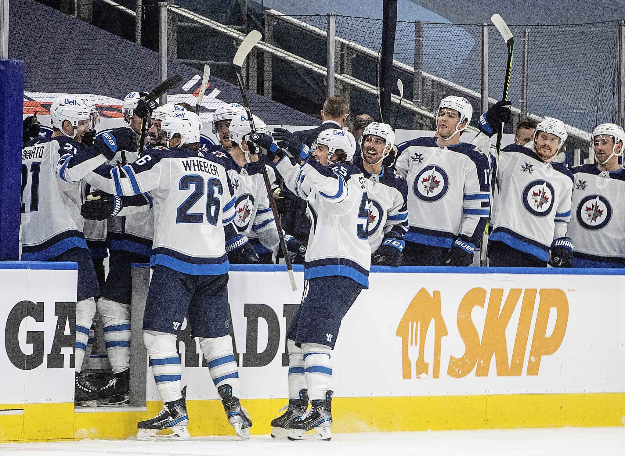 Winnipeg Jets celebrate a goal against the Edmonton Oilers during the third period. THE CANADIAN PRESS/Jason Franson