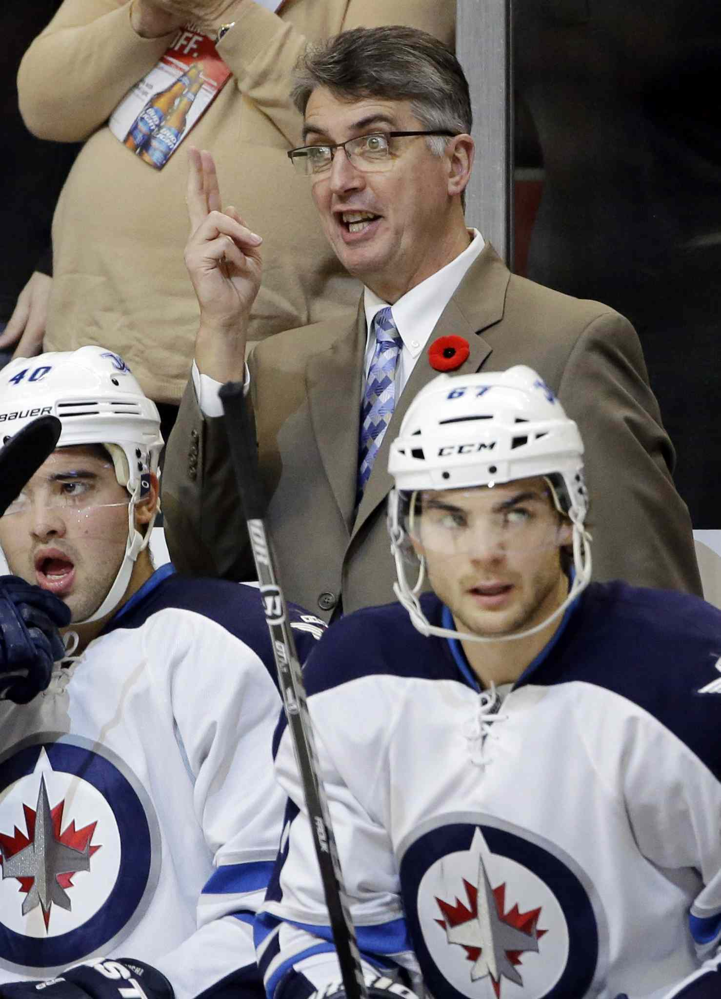 Winnipeg Jets head coach Claude Noel yells at his team after Jonathan Toews' first-period goal.