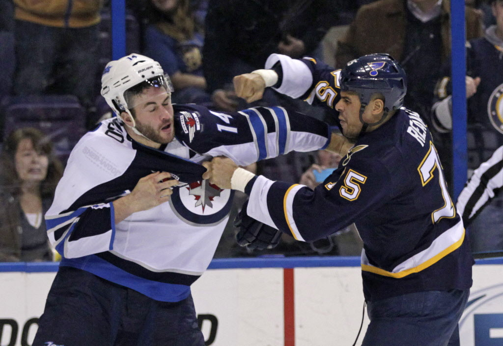 St. Louis Blues' Ryan Reaves (75) fights with Winnipeg Jets' Anthony Peluso (14). (Tom Gannam / The Associated Press )