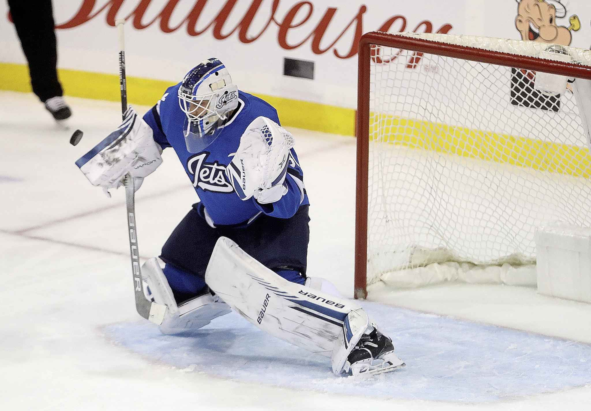 Winnipeg Jets' goaltender Laurent Brossoit makes a blocker save on a shot by the Chicago Blackhawks' during the first period in Winnipeg, Tuesday. It was the Blackhawks first shot of the game, more than 17 minutes after the first period started.