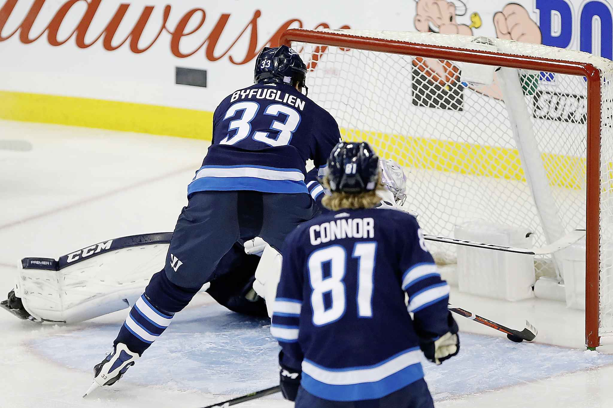 A Washington Capitals shot bounces off Winnipeg Jets goaltender Connor Hellebuyck toward the goal line but Dustin Byfuglien reached in and stopped the puck on the line during third period Wednesday.