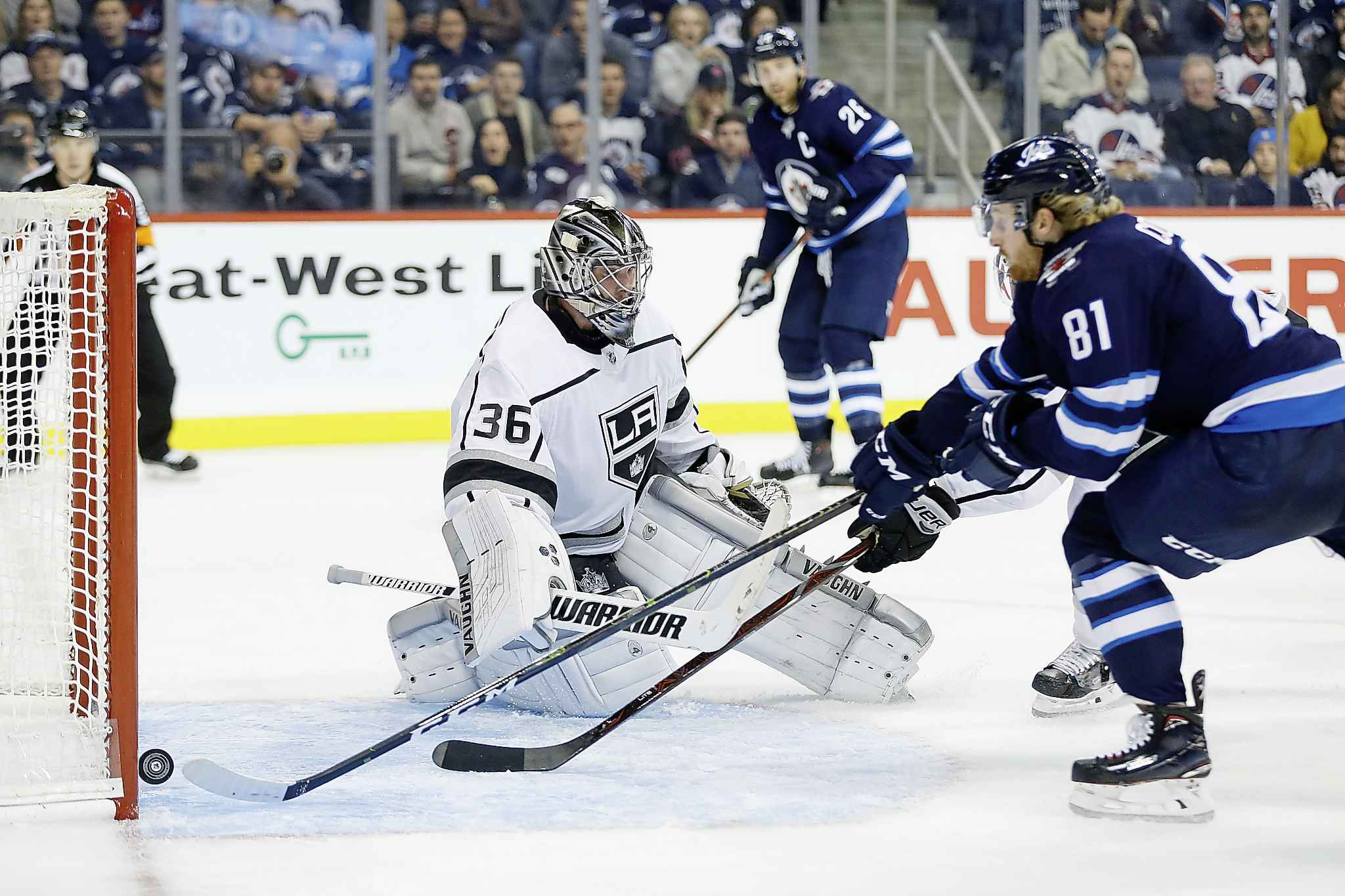 Winnipeg Jets' Kyle Connor scores a power play goal on a pass from Blake Wheeler against the Los Angeles Kings goaltender Jack Campbell during the second period in Winnipeg on Tuesday.