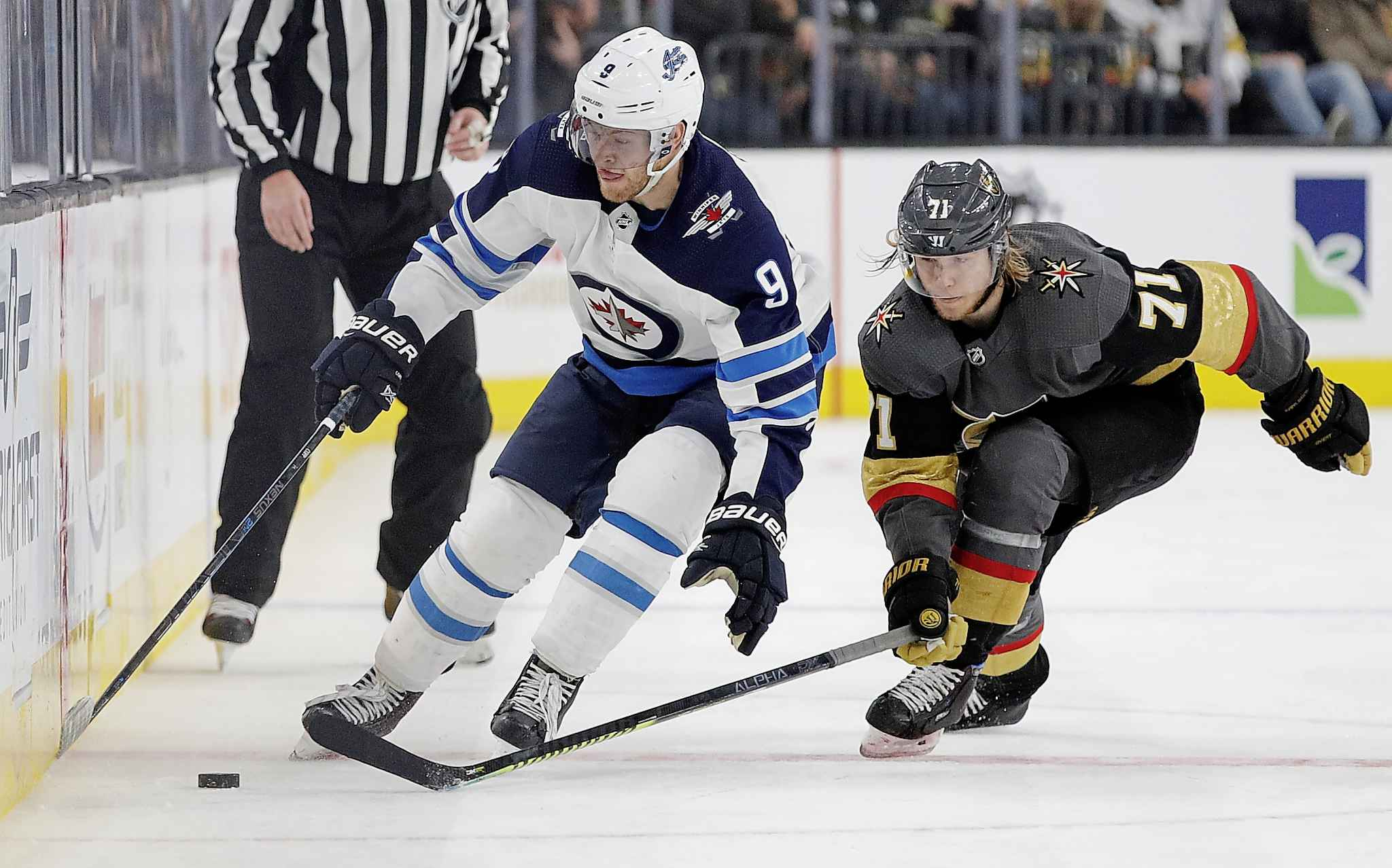Winnipeg Jets winger Andrew Copp and Vegas Golden Knights centre William Karlsson vie for the puck during the third period.