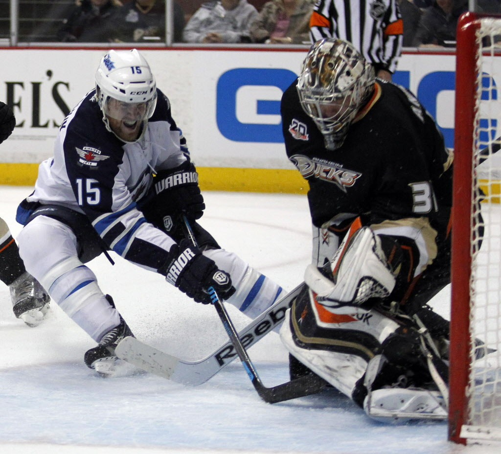 Winnipeg Jets' right wing Matt Halischuk (15) scores on Anaheim Ducks' goalie Frederik Andersen, right, in the first period of Monday's game in Anaheim. (Alex Gallardo / The Associated Press)