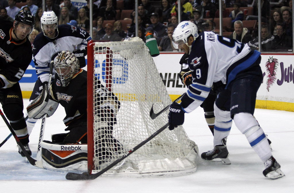 Winnipeg Jets' left wing Evander Kane (9) wraps a first-period shot against Anaheim Ducks' goalie Frederik Andersen during Monday's game in Anaheim.