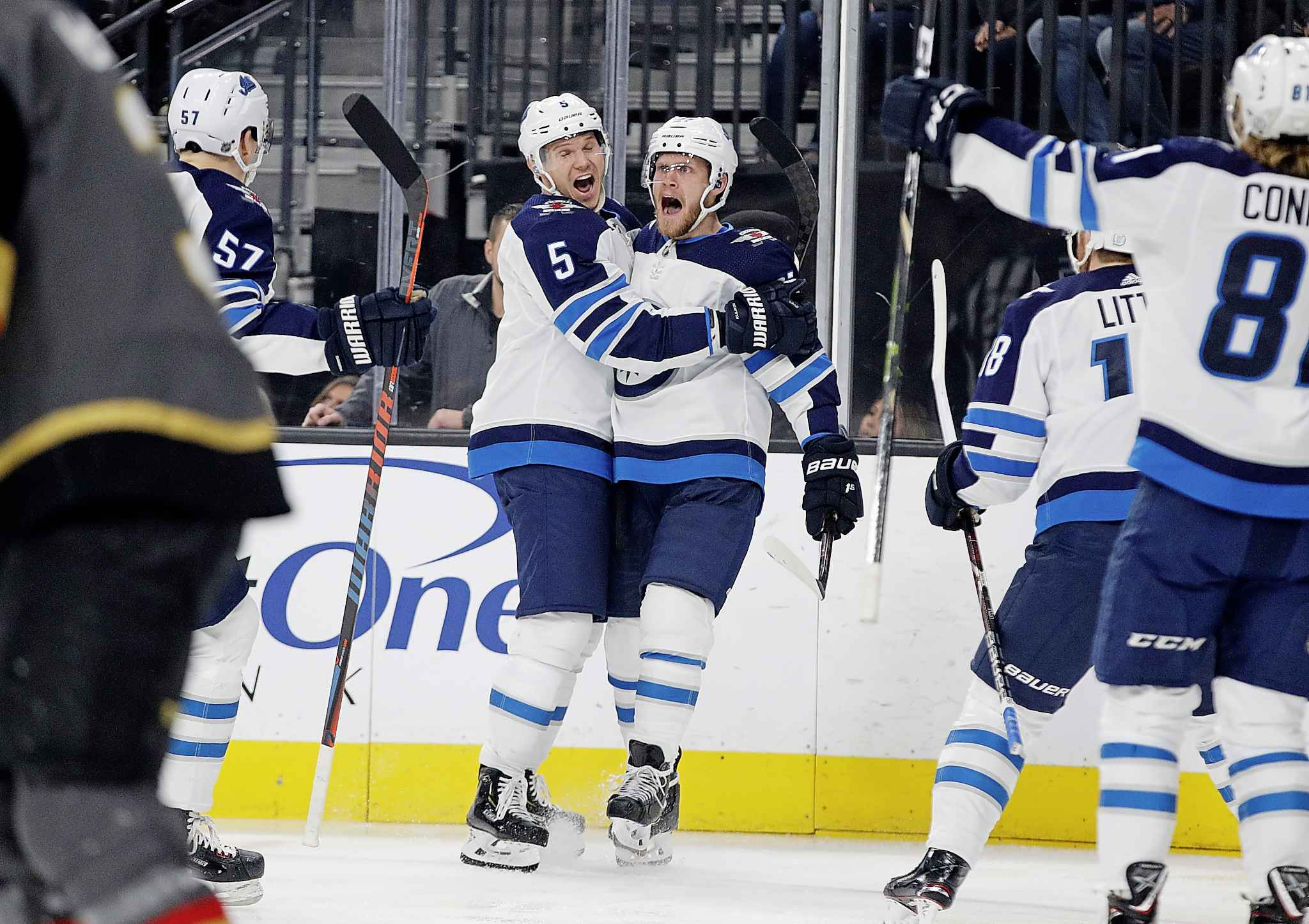 Winnipeg Jets defenceman Dmitry Kulikov celebrates after left wing Nikolaj Ehlers scored against the Vegas Golden Knights during the first period Friday.