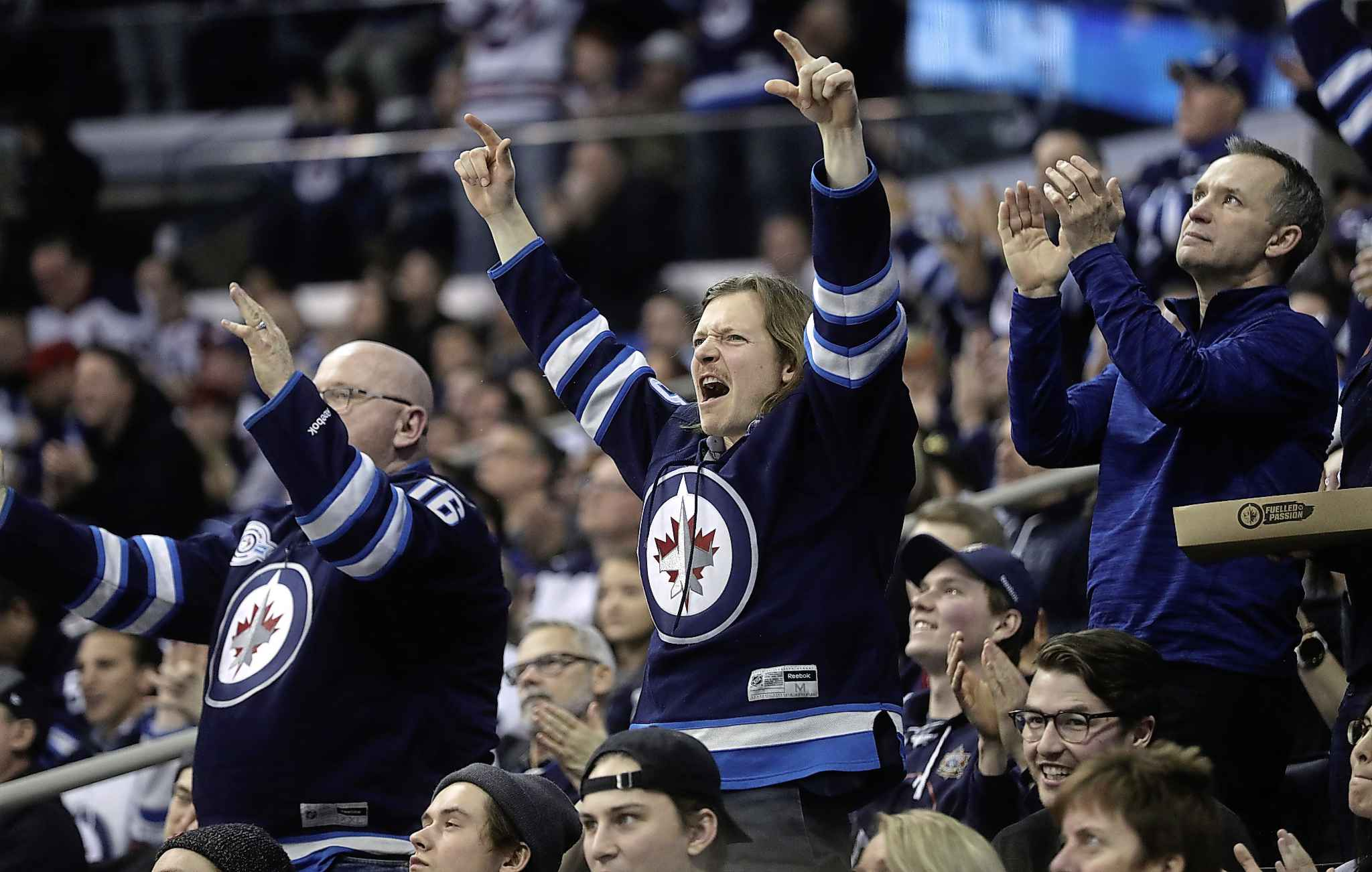 Winnipeg Jets fans celebrate during a game against the Vegas Golden Knights in January. The usually vociferous home crowds at Jets games have been oddly quiet this season.