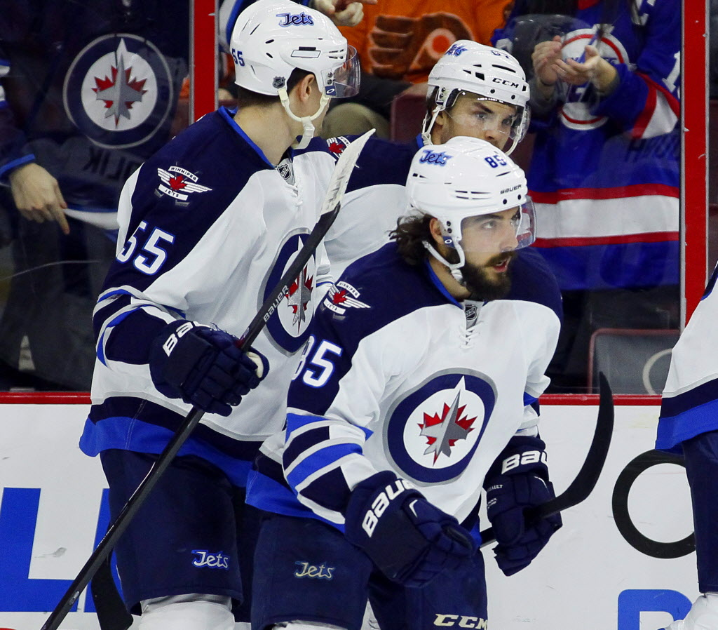 Winnipeg Jets' Mathieu Perreault (85) looks up at the replay board after scoring a goal in the first period. (Tom Mihalek / The Associated Press )