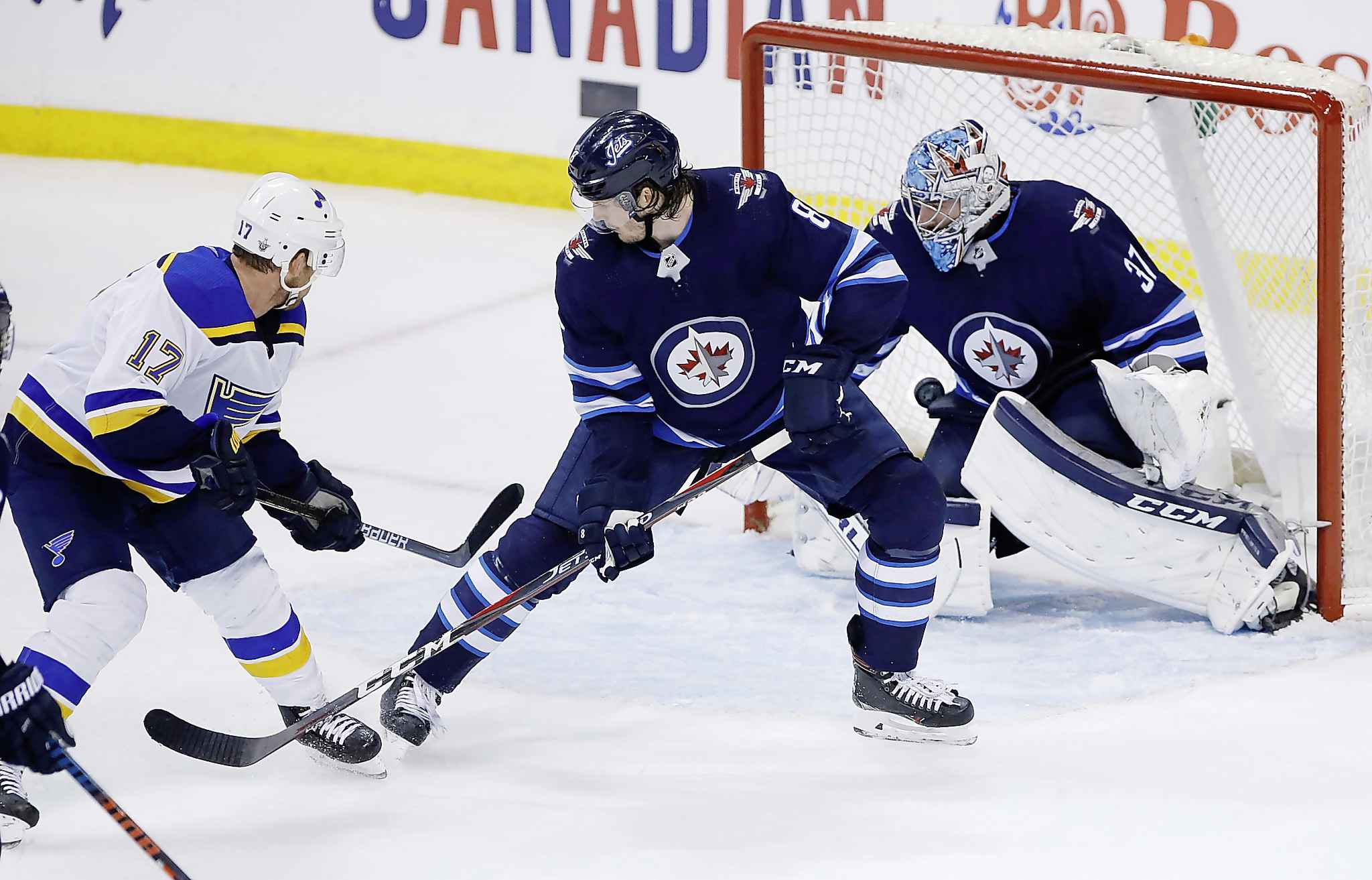 St. Louis Blues' Jaden Schwartz, left, scores the game-winning goal against the Winnipeg Jets with 15 seconds left in the third period to win game 5 of their first-round playoff series.