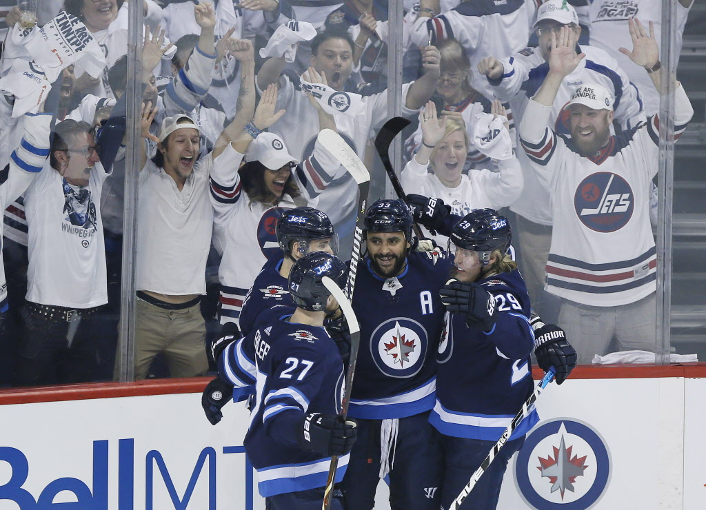 Winnipeg Jets' Nikolaj Ehlers (27), Mark Scheifele (55), Dustin Byfuglien (33) and Patrik Laine (29) celebrate Byfuglien's goal against the Vegas Golden Knights during first period of game one action in the NHL Western Conference Final in Winnipeg on Saturday, May 12, 2018. (John Woods / The Canadian Press files)