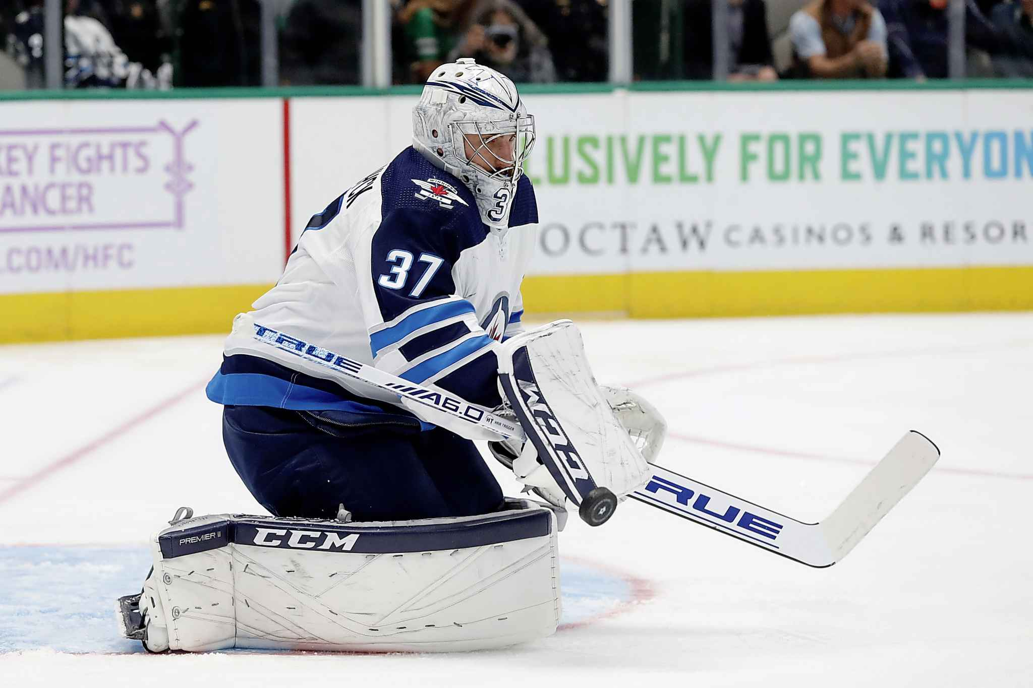 Winnipeg Jets goaltender Connor Hellebuyck blocks a shot from the Dallas Stars in the first period.