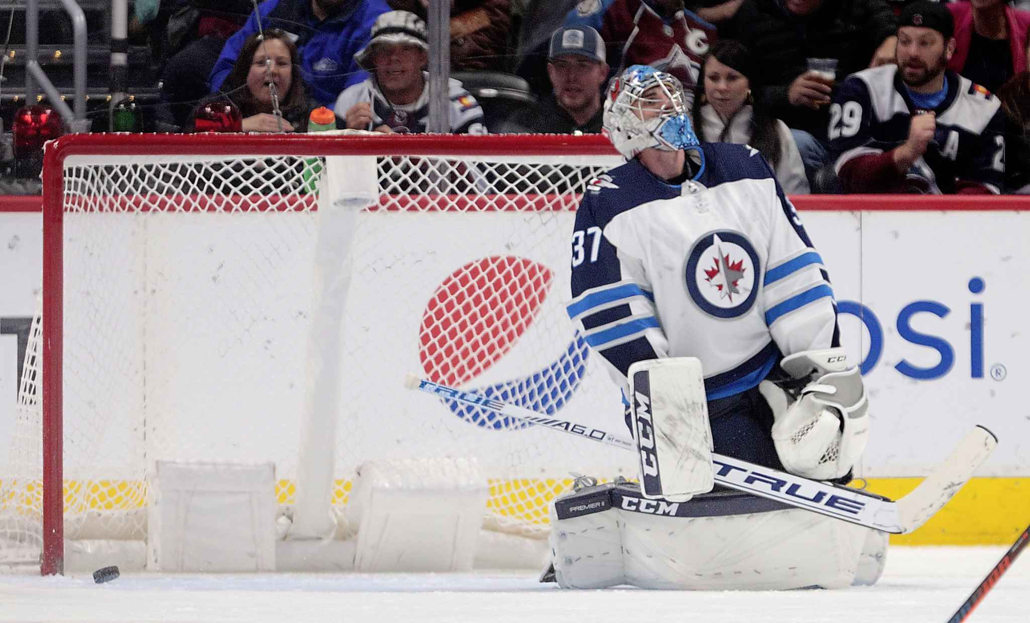 Winnipeg Jets goaltender Connor Hellebuyck reacts to Colorado Avalanche center Carl Soderberg's goal during the third period of an NHL hockey game in Denver, Thursday, April 4, 2019. Colorado won 3-2 in overtime. (AP Photo/Joe Mahoney)