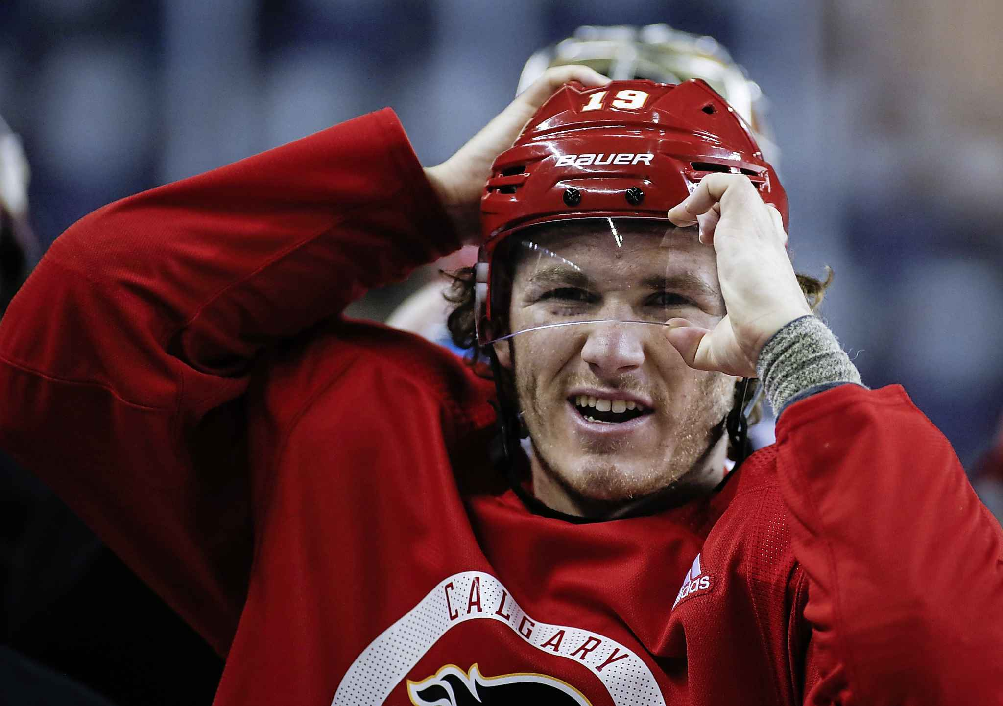 The Calgary Flames and Matthew Tkachuk agreed to a three-year, $7 million per year deal.