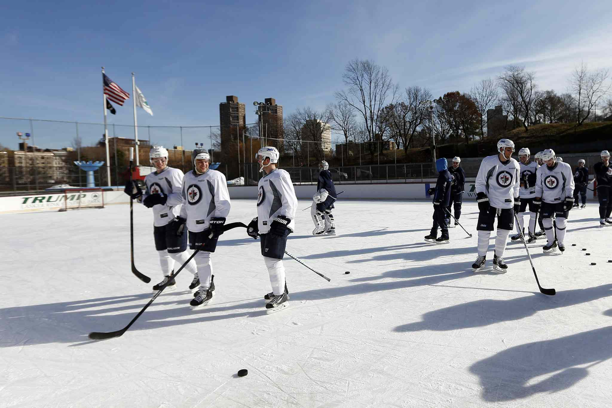 The Winnipeg Jets skate during practice at Lasker Rink in New York's Central Park Saturday.