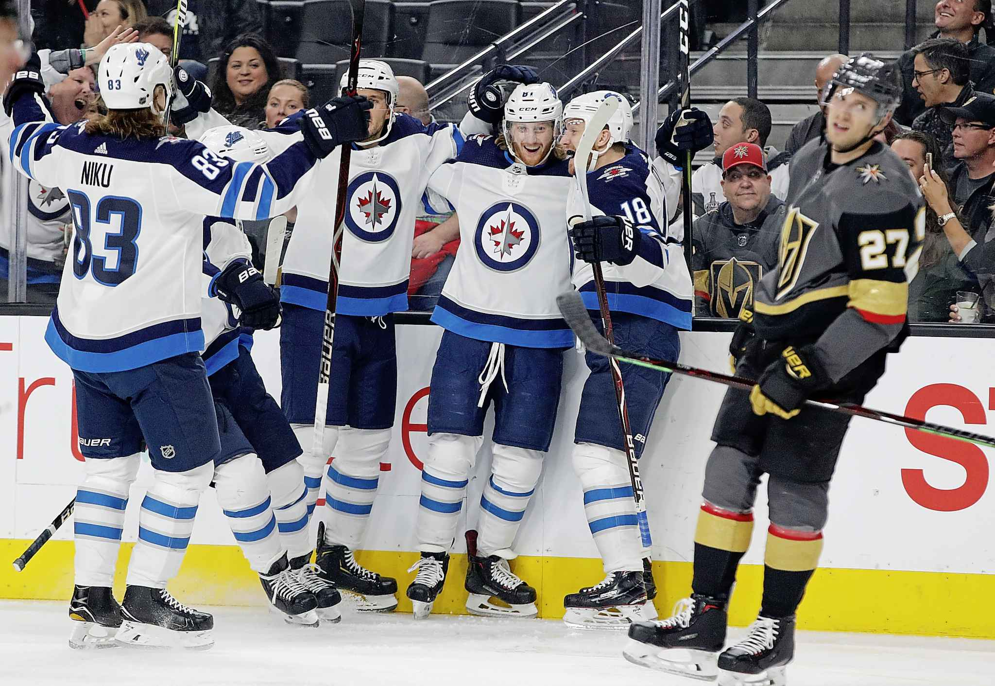 Winnipeg Jets left wing Kyle Connor, second from right at rear, celebrates with teammates after scoring against the Vegas Golden Knights during the first period Friday in Las Vegas.