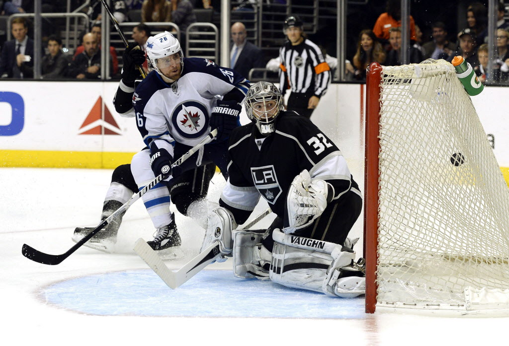 Winnipeg Jets right wing Blake Wheeler (26) scores a goal against Los Angeles Kings goalie Jonathan Quick (32) during the third period.