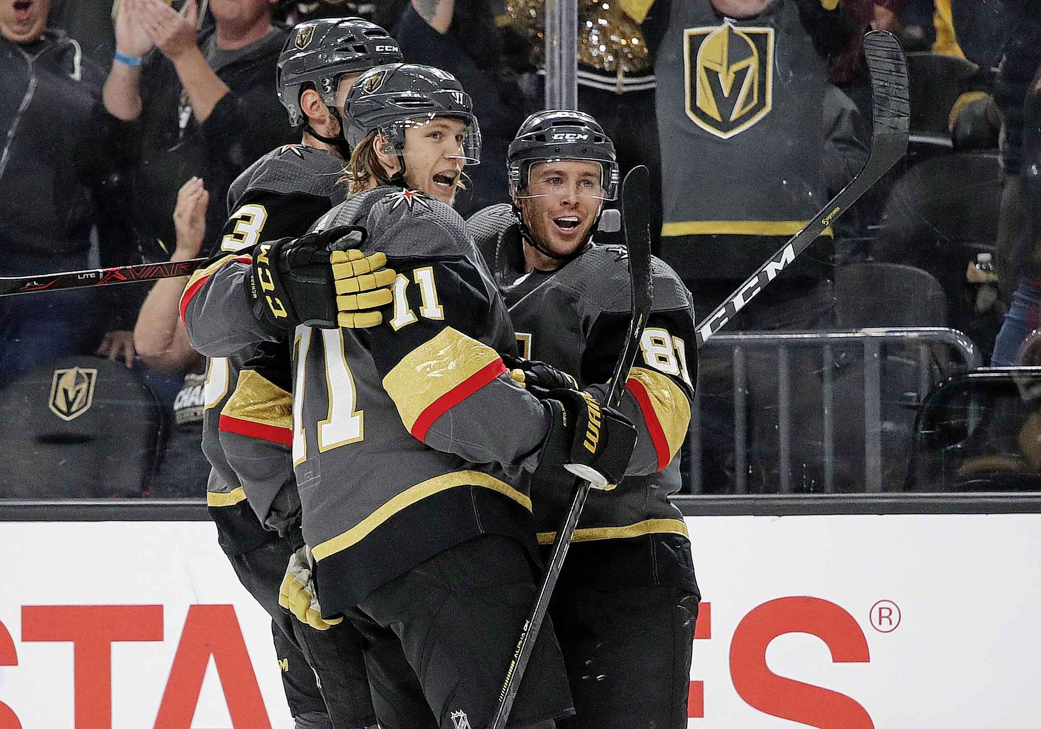 Vegas Golden Knights centre William Karlsson, middle, celebrates with teammates after scoring against the Winnipeg Jets during the second period.