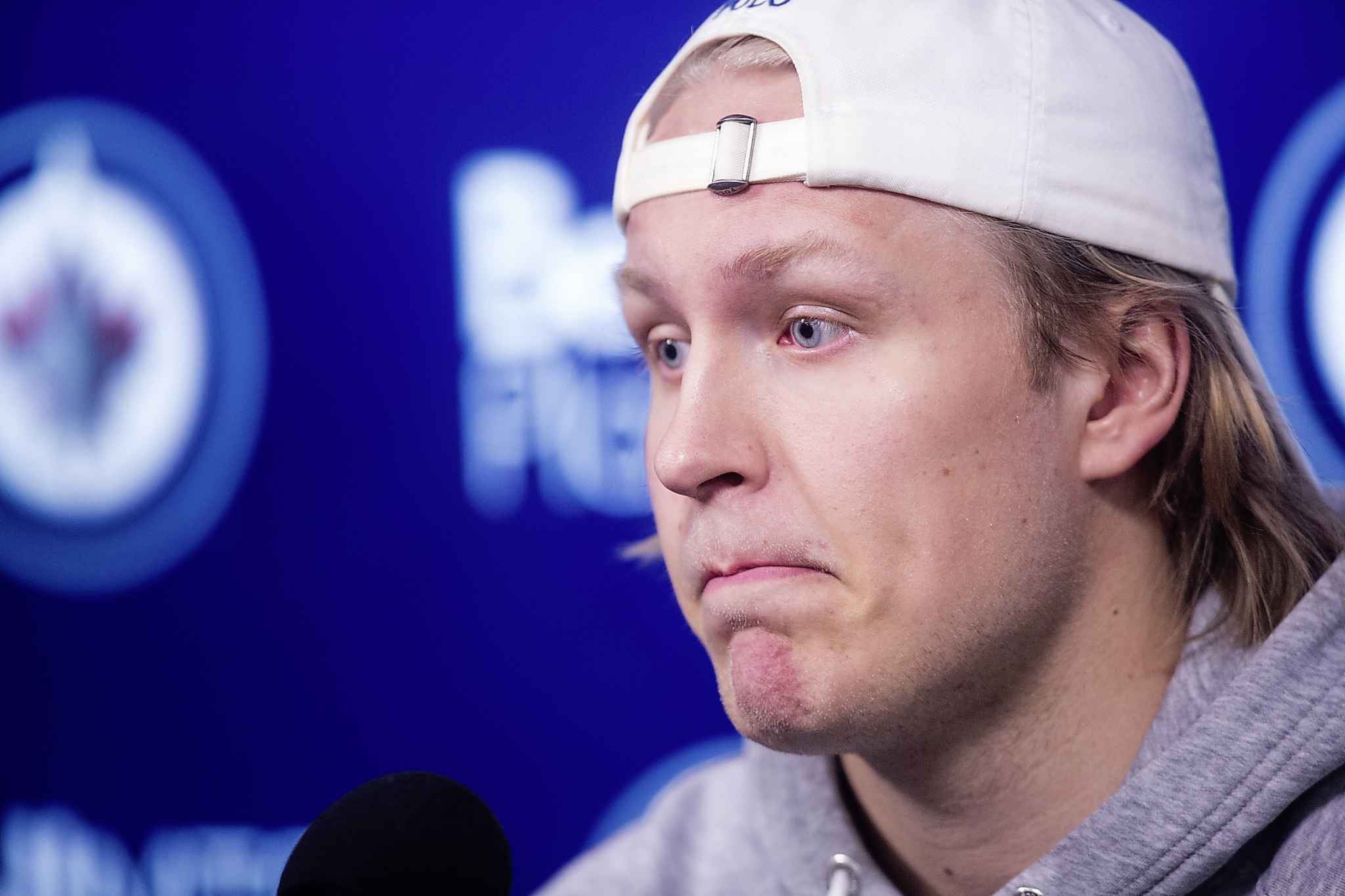 A clean-shaven Patrik Laine speaks to the media at the end of the Jets' season at the Bell MTS Centre on Monday.