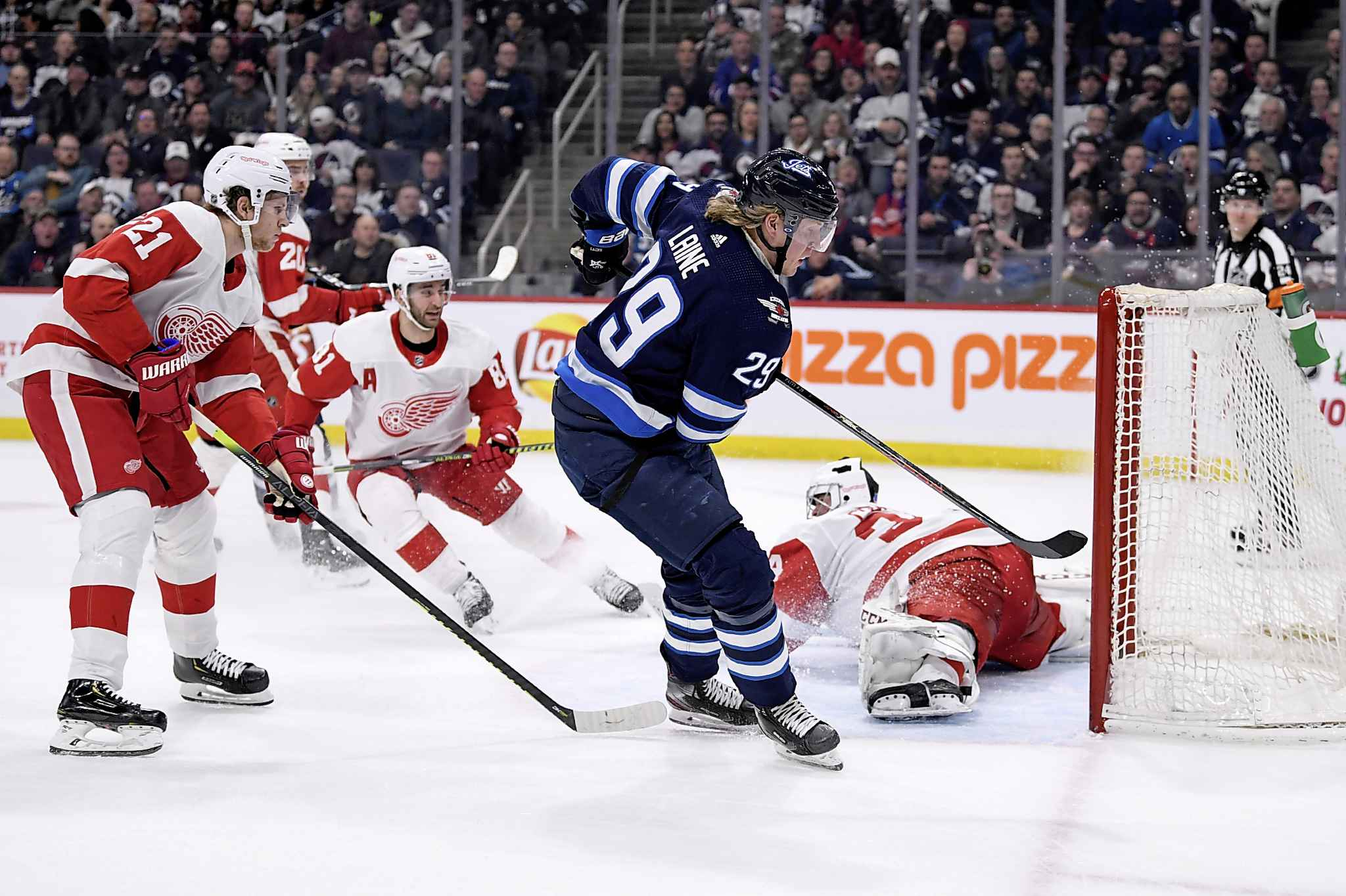 Winnipeg Jets' Patrik Laine scores on a deke around Detroit Red Wings goaltender Eric Comrie during the second period.